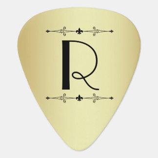 Oro y púa de guitarra negra del monograma del art