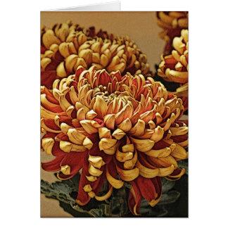 Oro y tarjeta de felicitación roja del crisantemo