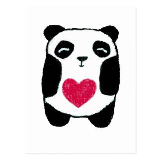 Oso de panda con una postal del corazón