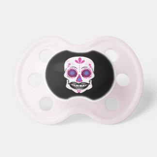 Pacificador rosado negro del cráneo del caramelo chupete