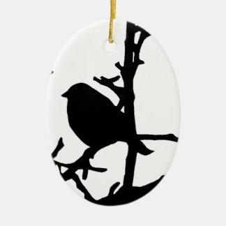 Pájaro en una rama adorno ovalado de cerámica
