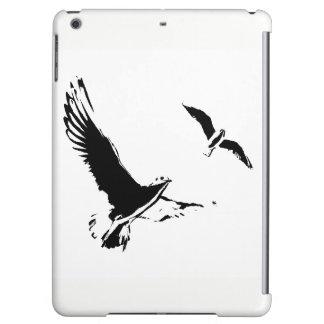 Pájaros de vuelo negros y blancos - caja del aire