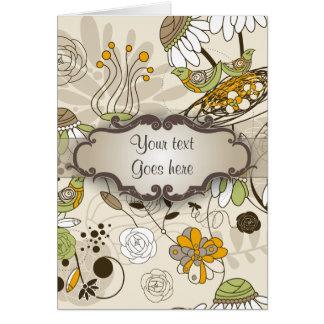 Pájaros y flores verdes en moreno con el letrero tarjeta de felicitación