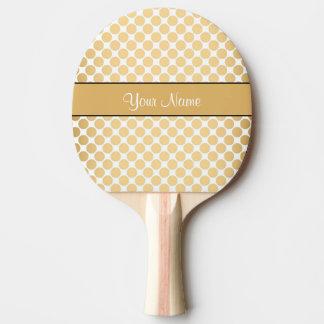 Pala De Ping Pong Lunares del oro en el fondo blanco