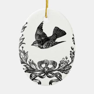 paloma del diseño de la tipografía del vintage y adorno navideño ovalado de cerámica