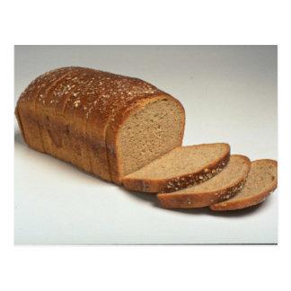 Pan cortado delicioso del trigo postal