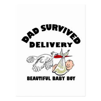 Papá e hijo hermoso del bebé postal