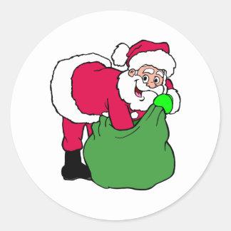 Papá Noel alcanza en paquete Pegatina Redonda