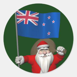Papá Noel con la bandera de Nueva Zelanda Etiqueta Redonda