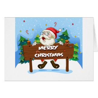 Papá Noel en la parte posterior de un letrero de Tarjeta De Felicitación