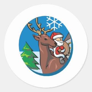 Papá Noel monta el reno Pegatina Redonda