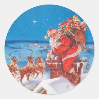Papá Noel para arriba en el tejado con su reno Pegatina Redonda