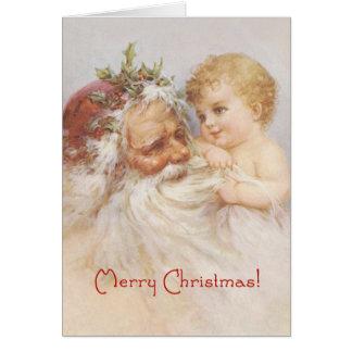Papá Noel y bebé por la tarjeta del pliegue de