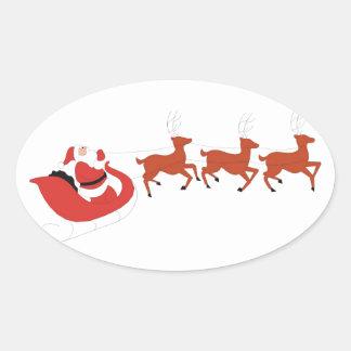Papá Noel y su reno Pegatina Ovalada