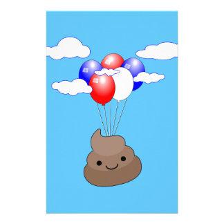 Papelería Vuelo de Poo Emoji con los globos en cielo azul