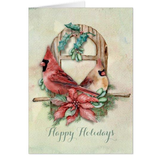 Pares de los cardenales del invierno con el tarjeta de felicitación