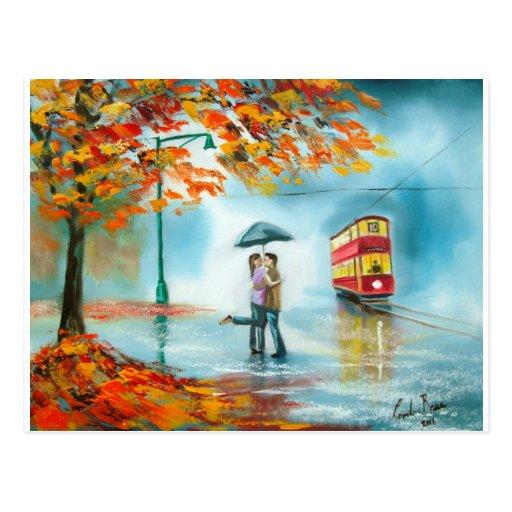 Pares románticos del paraguas rojo de la tranvía d postales