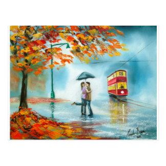 Pares románticos del paraguas rojo de la tranvía postal