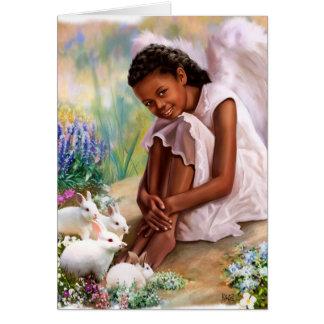 Pascua feliz. Poco ángel con las tarjetas de los
