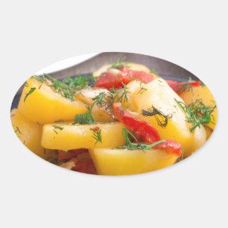 Patatas guisadas con el primer del paprika pegatina ovalada