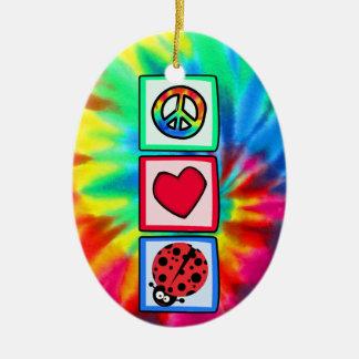 Paz, amor, mariquitas adorno ovalado de cerámica