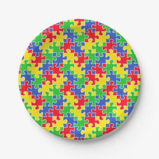 Pedazos brillantes del rompecabezas de los colores plato de papel