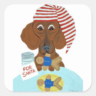 Pegatina Cuadrada Dachshund que guarda las galletas de Santa