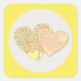 Pegatina Cuadrada Dos corazones del purpurina del oro