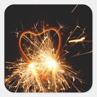 Pegatina Cuadrada Foto macra de un sparkler ardiente en forma de un