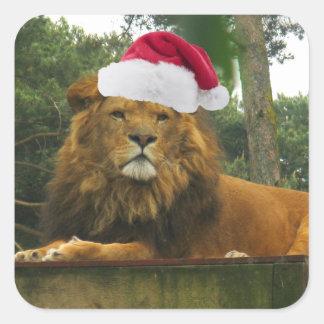 Pegatina Cuadrada León del navidad que lleva el gorra de Santa