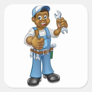 Pegatina Cuadrada Manitas del mecánico o del fontanero con la llave