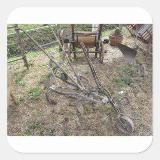 Pegatina Cuadrada Paleta vieja del hierro y otras herramientas