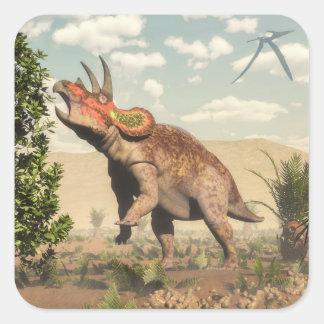 Pegatina Cuadrada Triceratops que come en el árbol de la magnolia -