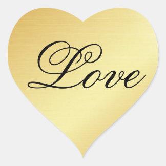 Pegatina del corazón del oro con amor en texto de