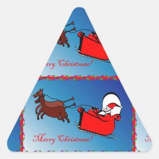 Pegatina del triángulo con Santa en su trineo