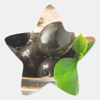 Pegatina En Forma De Estrella Brown conservó en vinagre aceitunas en el viejo