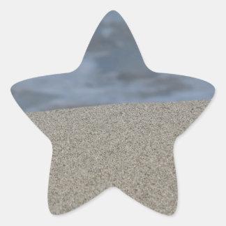 Pegatina En Forma De Estrella El primer de la playa de la arena con el mar