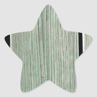 Pegatina En Forma De Estrella Verde y calzada de madera del tablón de Brown