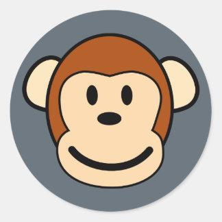 Pegatina feliz de la cara del mono