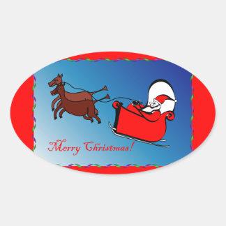 Pegatina oval con Santa en su trineo