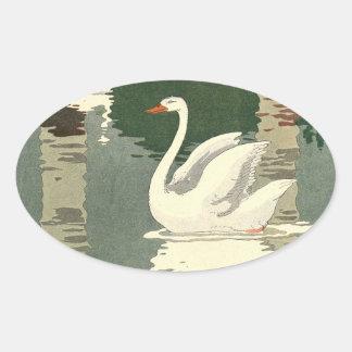 Pegatina Ovalada Cisne blanco reflejado en el lago