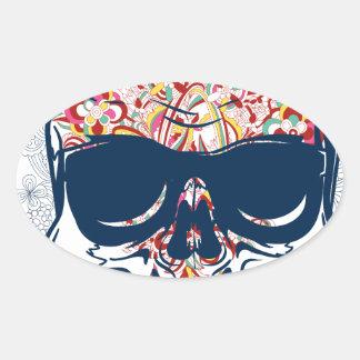 Pegatina Ovalada diseño coloreado zombi muerto del cráneo