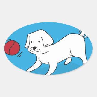 Pegatina Ovalada Perro que juega con una bola