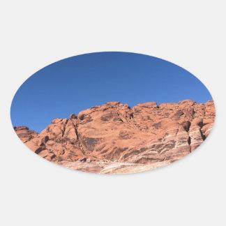 Pegatina Ovalada Rocas rojas y cielos azules