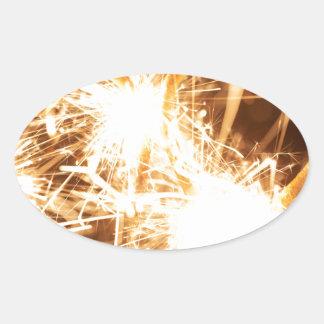Pegatina Ovalada Sparkler ardiente en forma de un corazón