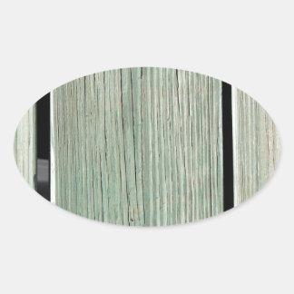 Pegatina Ovalada Verde y calzada de madera del tablón de Brown