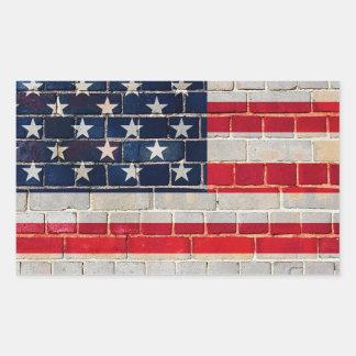 Pegatina Rectangular Bandera de América en una pared de ladrillo