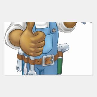 Pegatina Rectangular Manitas del mecánico o del fontanero con la llave