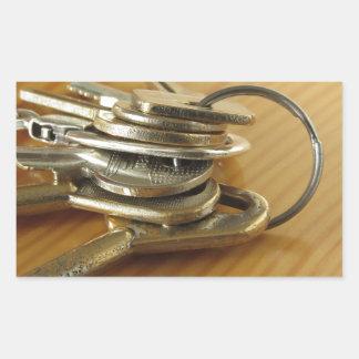 Pegatina Rectangular Manojo de llaves gastadas de la casa en la tabla
