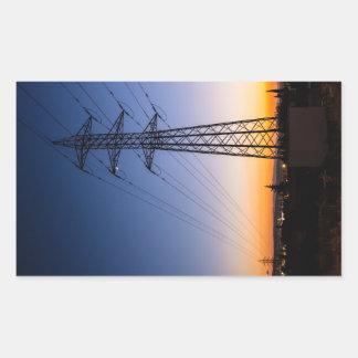 Pegatina Rectangular Torre de la electricidad cerca de una zona urbana